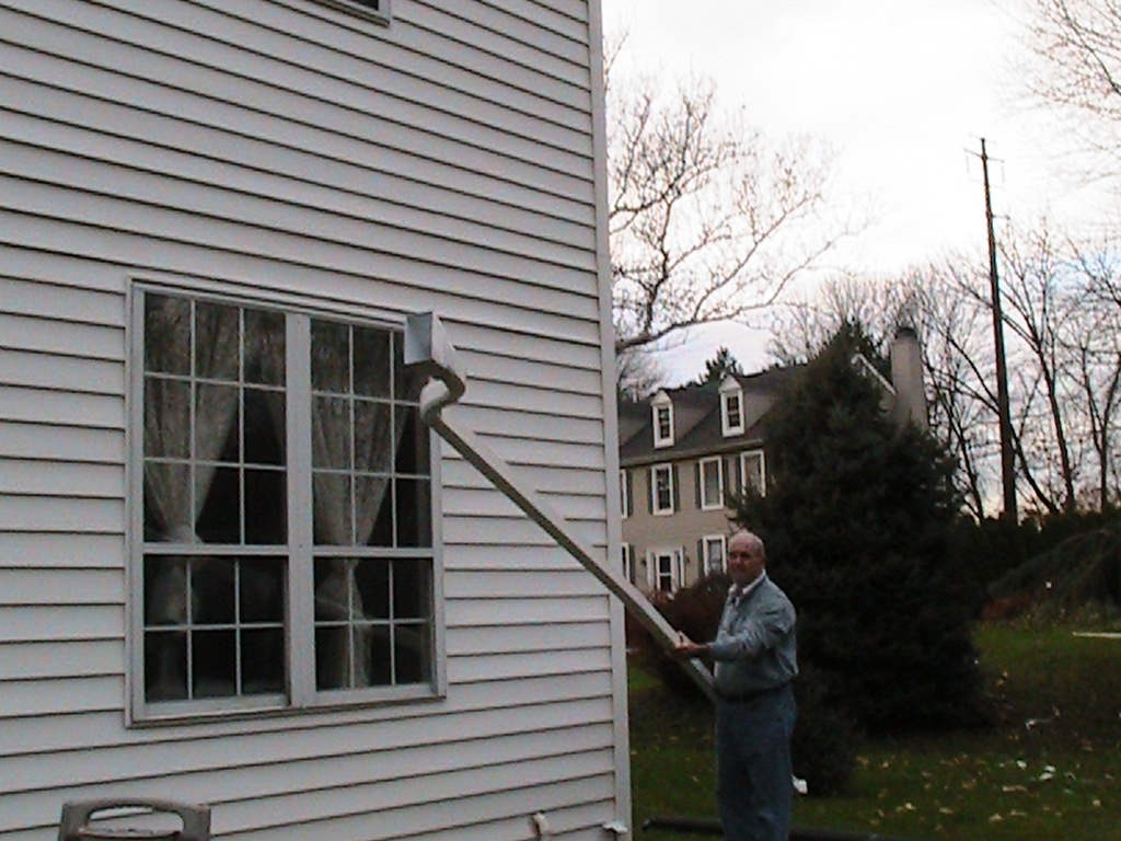 The Spoutoff Clean Your Rain Gutters From The Safety Of