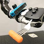 Hand-Mounted Camera Improves Robotic Dexterity