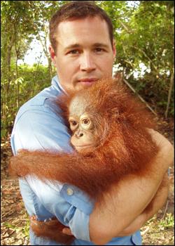 Jeff Corwin holding a baby orangutang